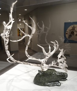 Intricate carvings of animals in caribou antler