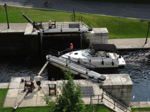 The water levels are raised and lowered allowing passage of the boats through the hand operated locks